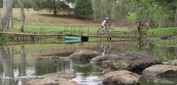 crossing bridge Dargle mtb by Nkulu Mdladla